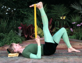 Yogini Kaliji in TriYoga Leg Stretch with tie