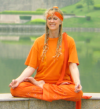 Yogini Kaliji in meditation in China, in front of lake
